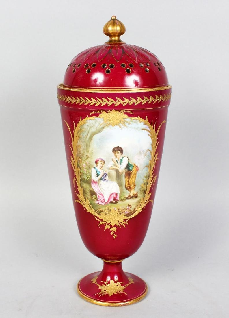 A SEVRES RED PORCELAIN VASE AND COVER, painted with