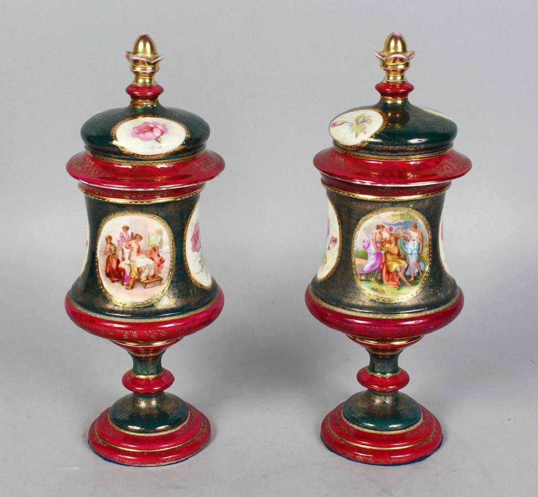 A PAIR OF VIENNA PORCELAIN VASES AND COVERS with panels