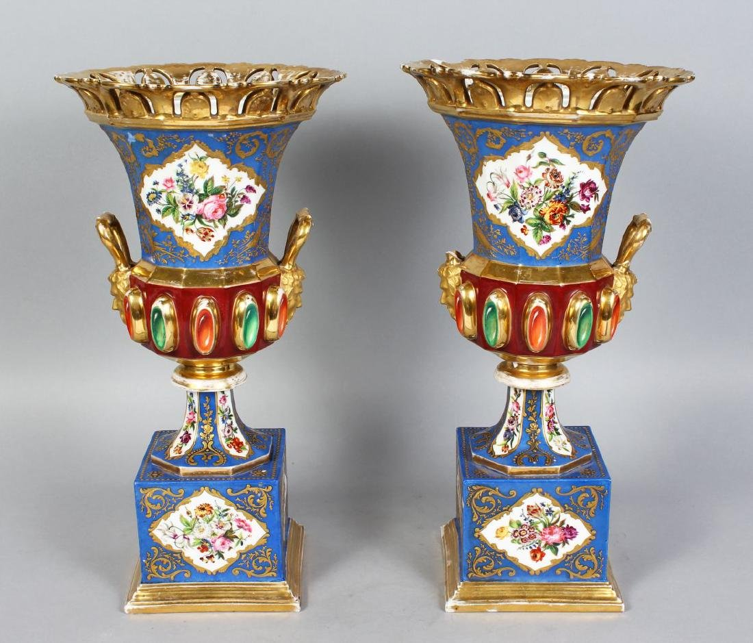 A PAIR OF CONTINENTAL PORCELAIN URN SHAPED VASES AND