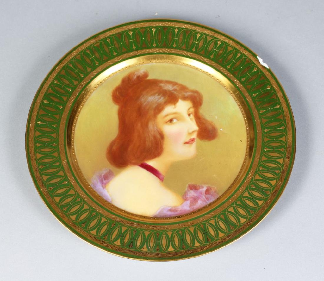 A VIENNA PORCELAIN PLATE OF A YOUNG LADY.  9ins