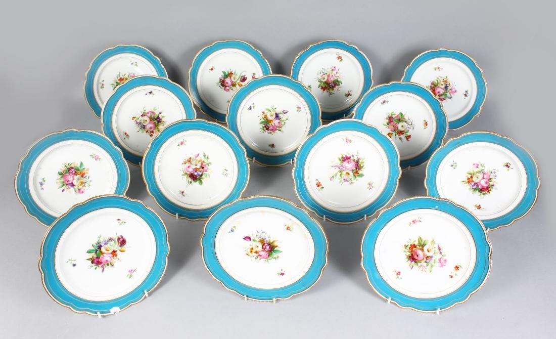 A SET OF FOURTEEN FRENCH PORCELAIN PLATES, with blue