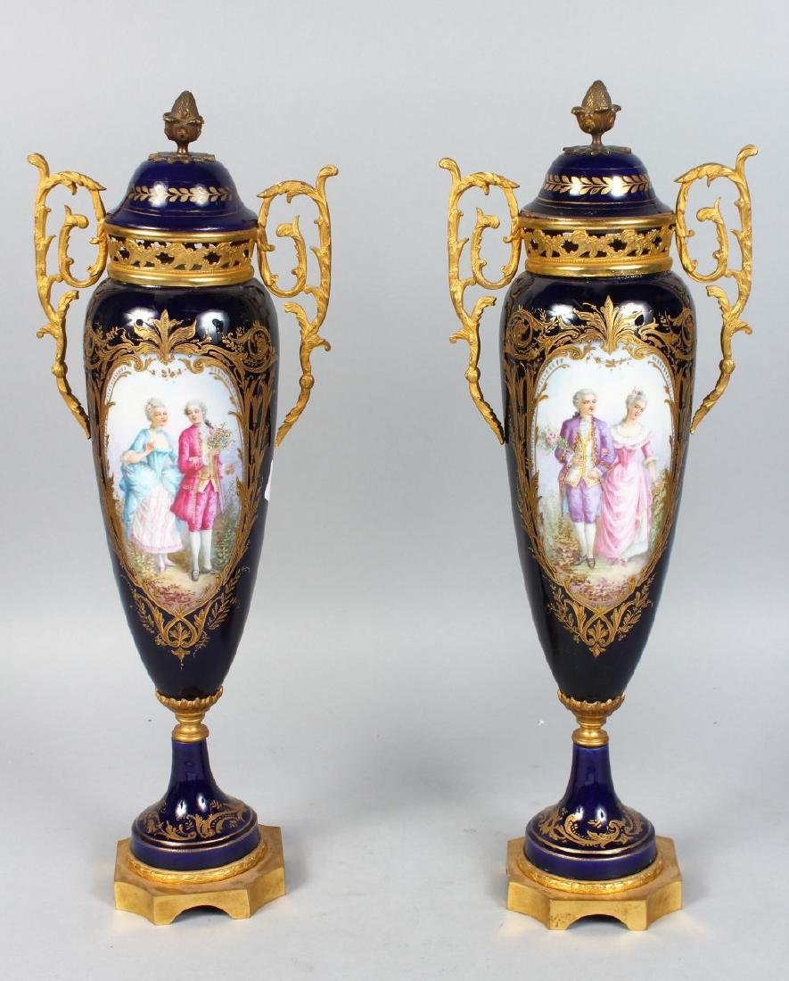 A GOOD PAIR OF SEVRES BLUE TAPERING VASES AND COVERS,