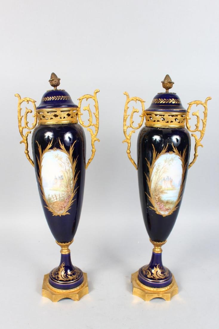 A GOOD PAIR OF SEVRES BLUE TAPERING VASES AND COVERS, - 2
