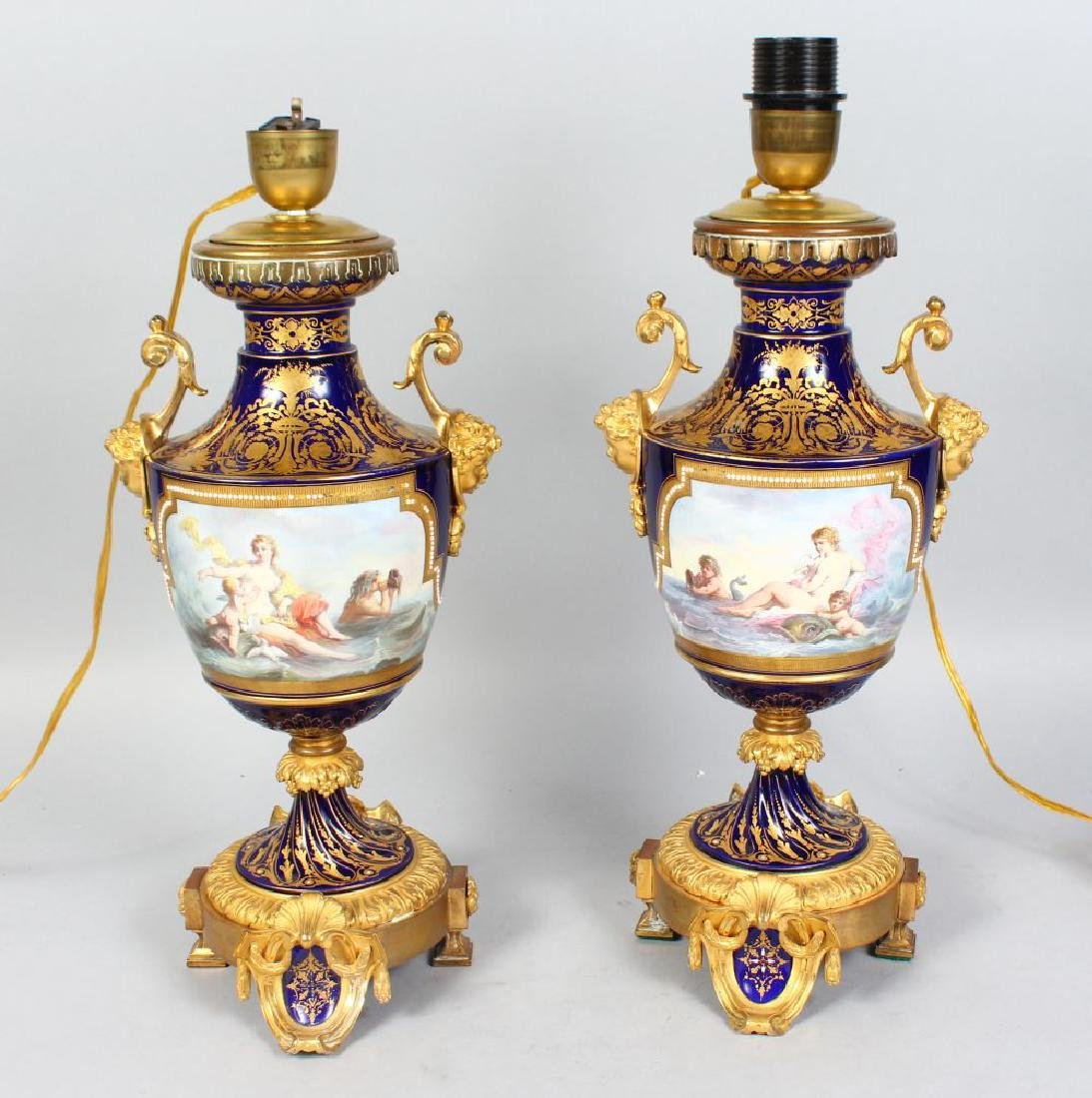 A SUPERB PAIR OF SEVRES PORCELAIN URN SHAPED LAMPS with