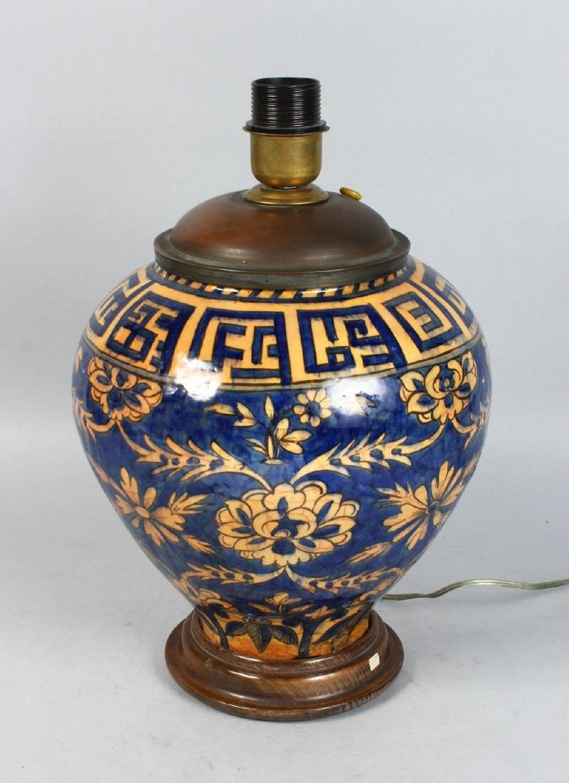 A BULBOUS ISLAMIC POTTERY VASE, converted to a lamp.