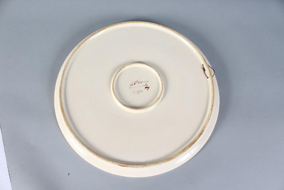 A MOORCROFT STYLE CIRCULAR PORCELAIN CHARGER.  14ins - 2