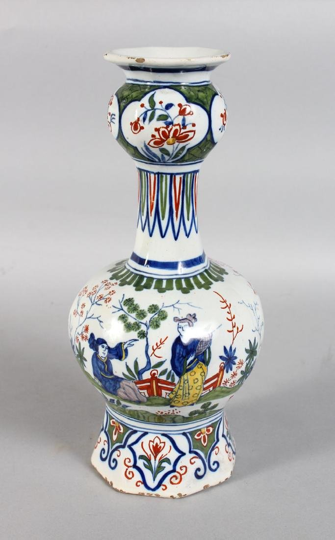 A DELFT TIN GLAZE BULBOUS VASE decorated with Chinese