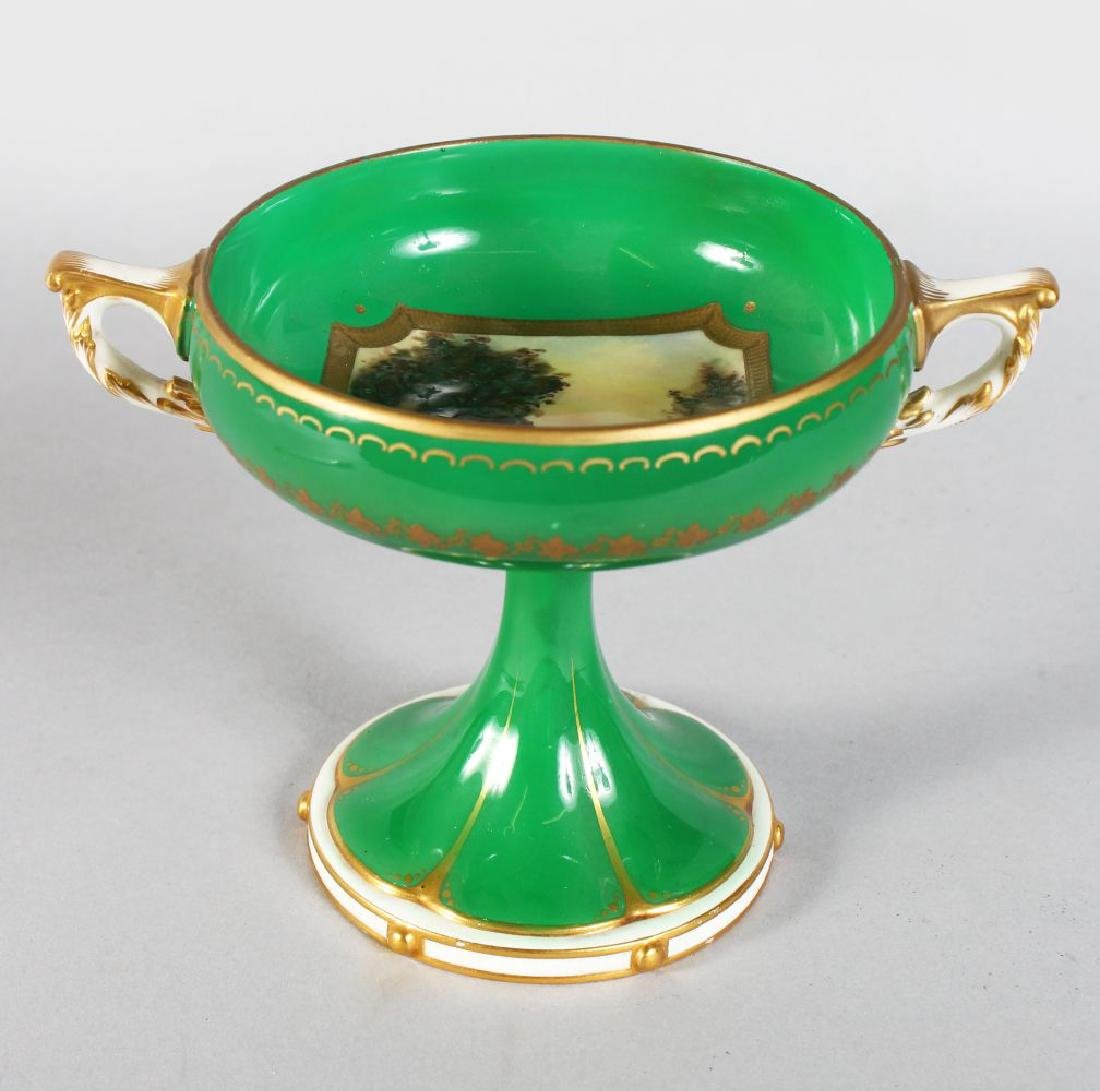 A ROYAL WORCESTER TWO-HANDLED PEDESTAL COMPORT, the