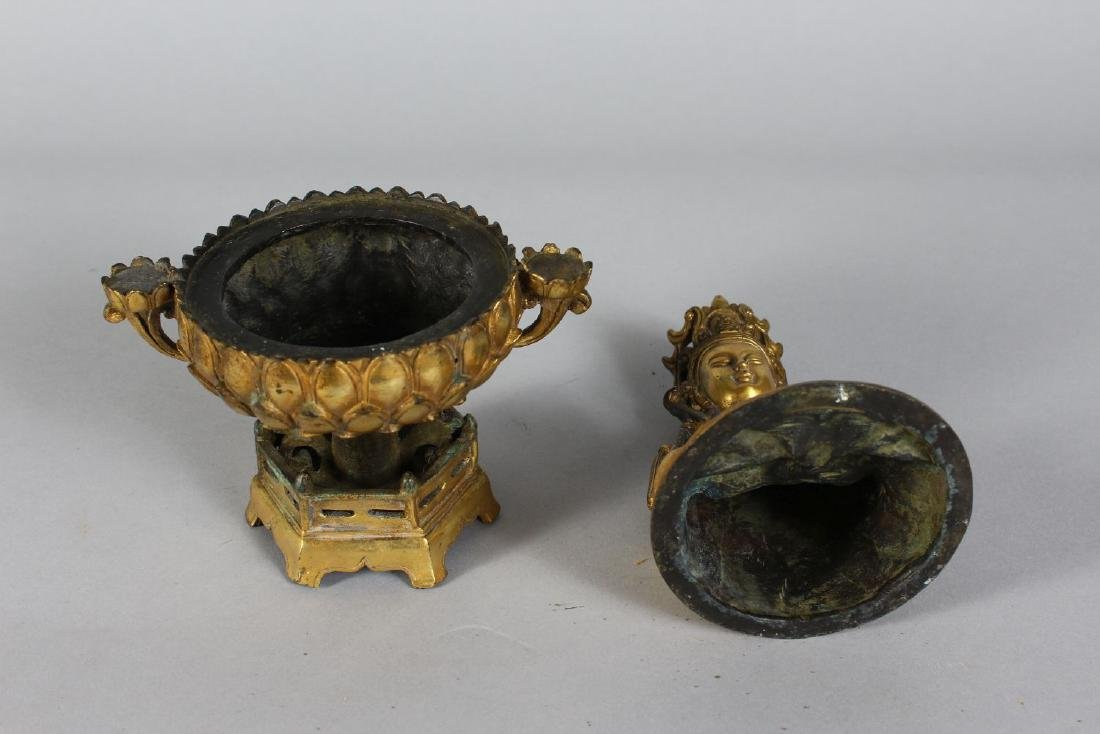 A CHINESE GILT BRONZE DEITY on a stand.  10ins high. - 2