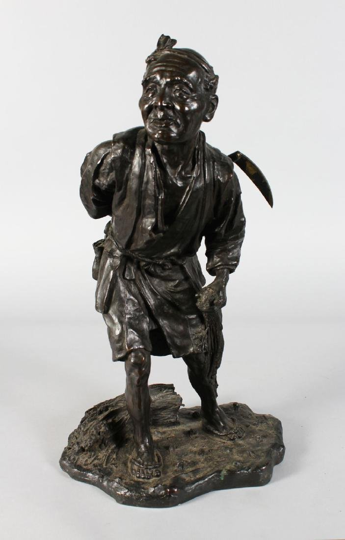 A SUPERB JAPANESE BRONZE of a man carrying a scythe.