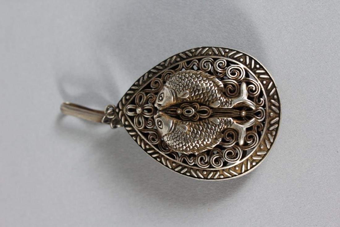 A CHINESE SILVER FISH PENDANT.