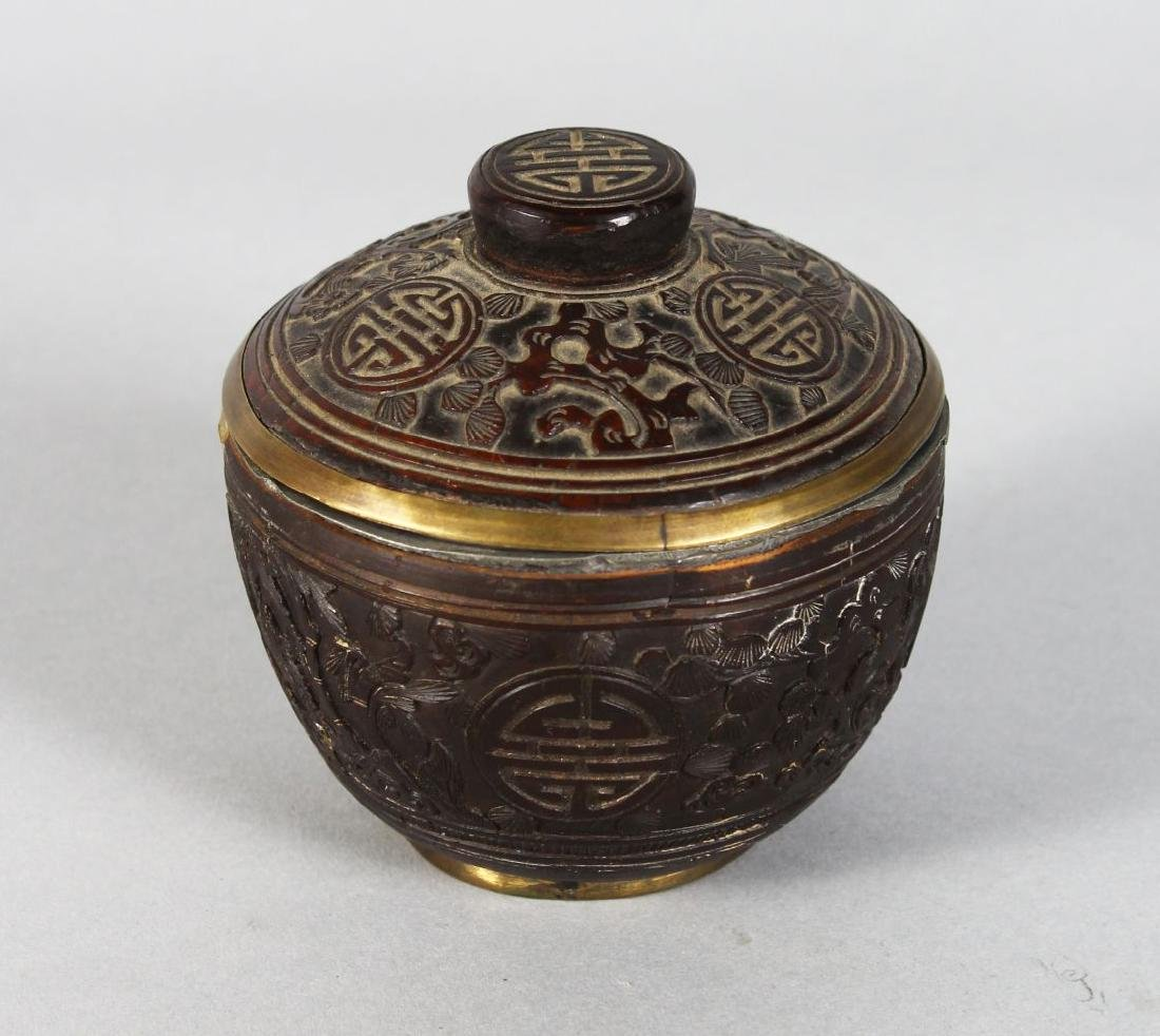 A SMALL CARVED CIRCULAR COCONUT POT AND COVER. 3ins