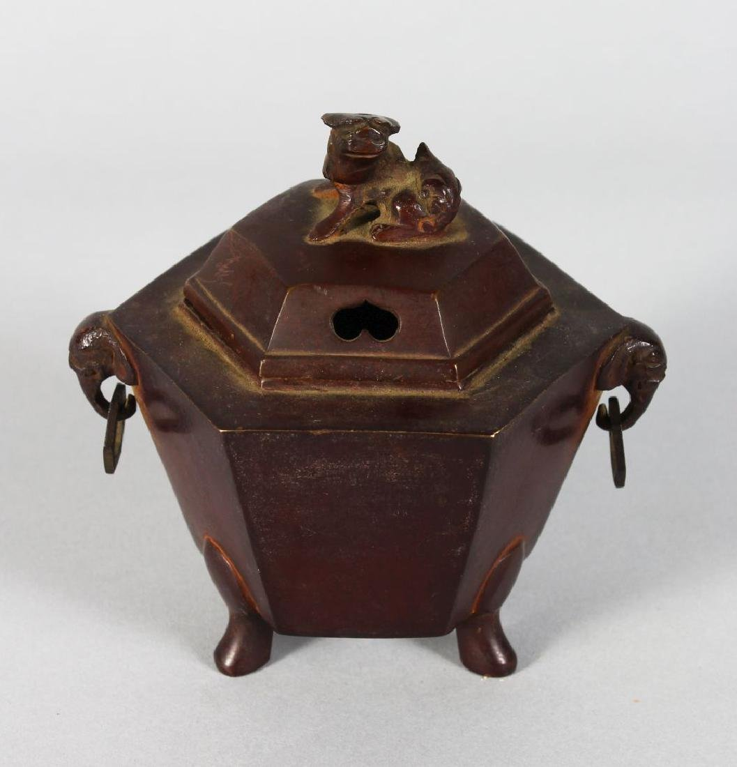 A CHINESE BRONZE OCTAGONAL CENSER, the lid with dog of