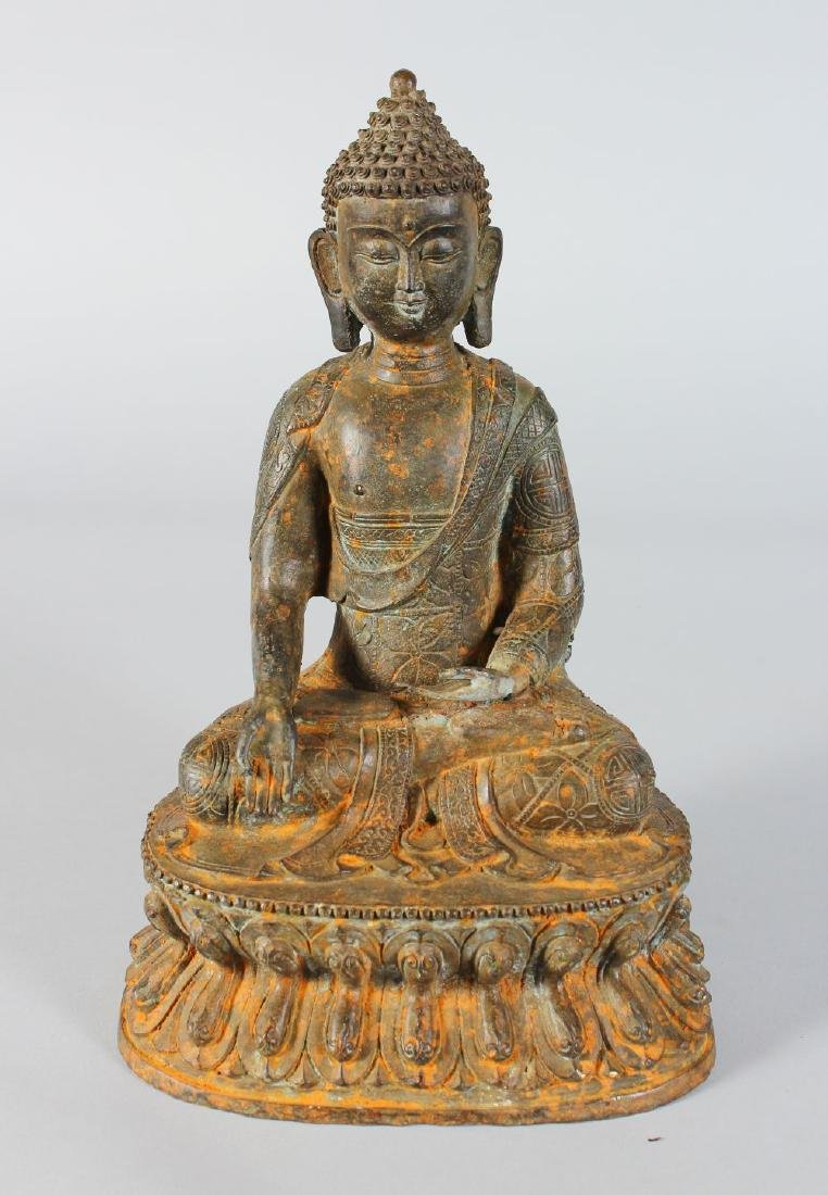 A CHINESE SEATED BRONZE GOD. 11ins high.