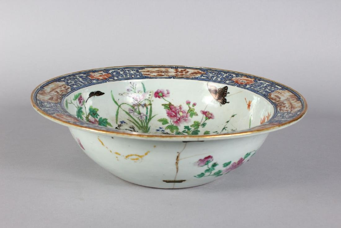 A CHINESE CIRCULAR ENAMEL DECORATED BOWL (AF).  15ins - 2