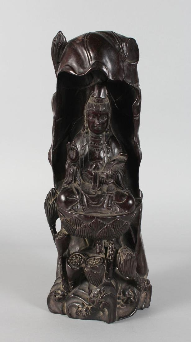 A CHINESE CARVED REDWOOD GUANYIN FIGURE. 18ins high.