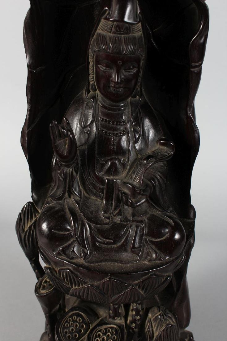 A CHINESE CARVED REDWOOD GUANYIN FIGURE. 18ins high. - 2