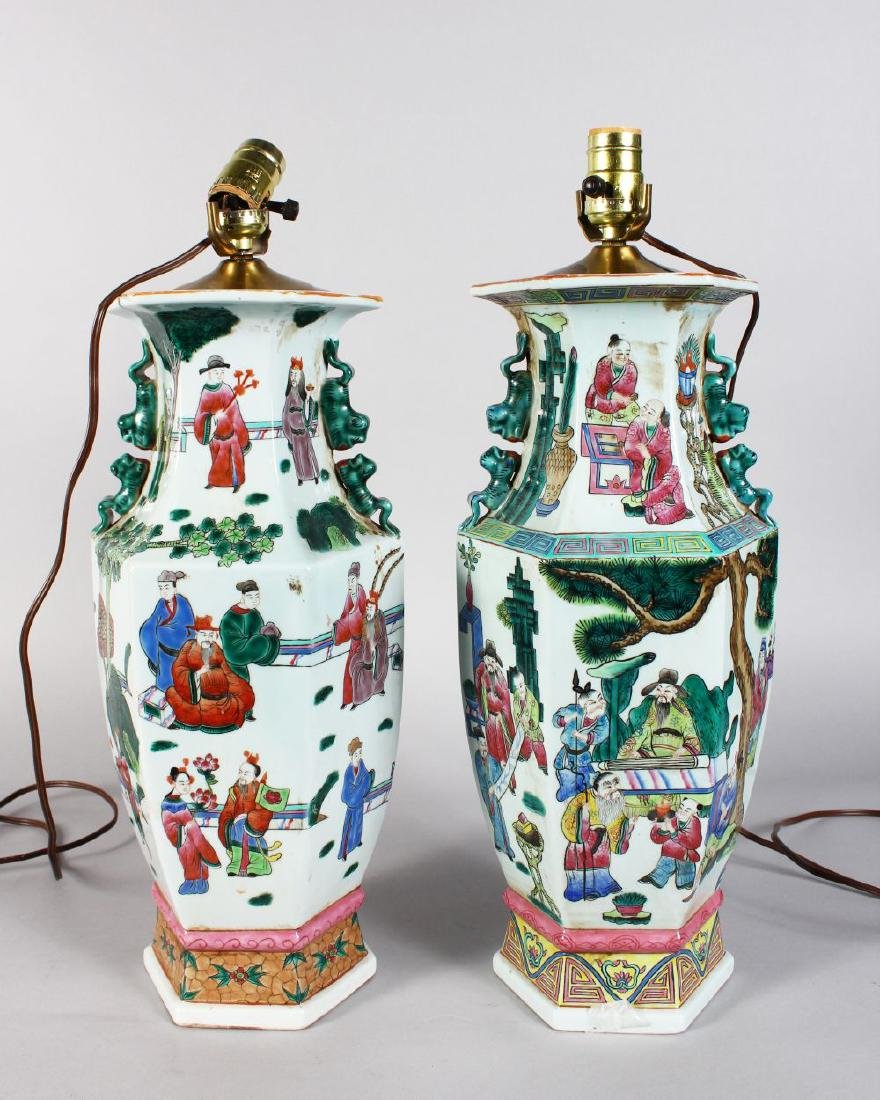 A PAIR OF CHINESE LAMPS, painted with figures. 17ins