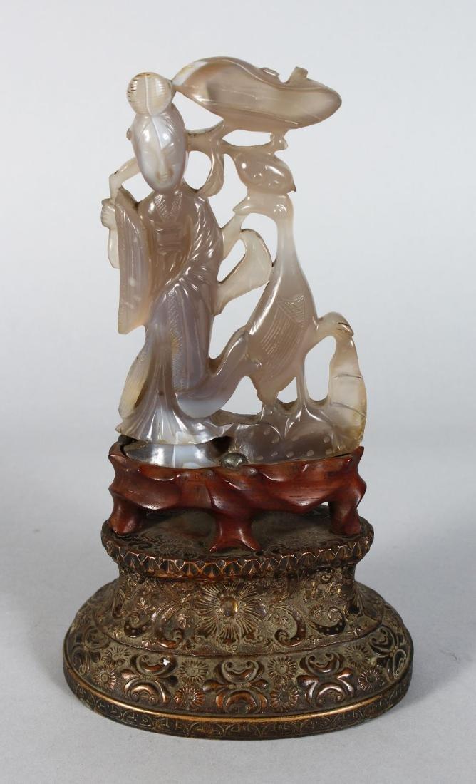 A CARVED AGATE GUANYIN on a bronze base. 10ins high.