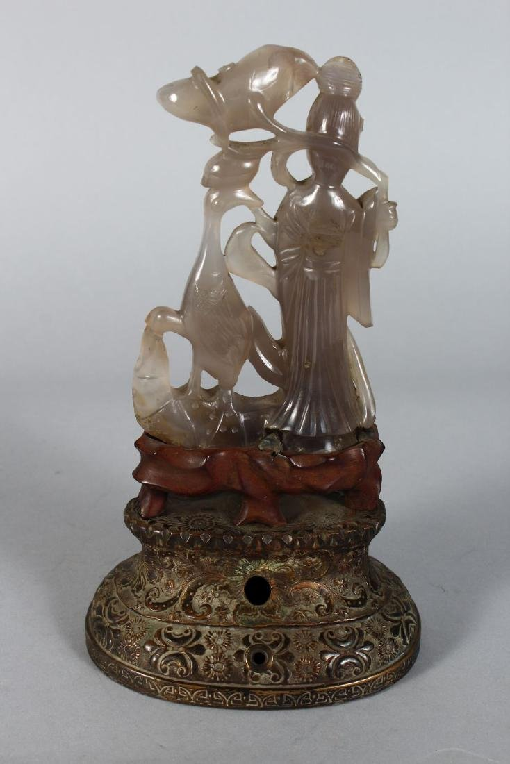 A CARVED AGATE GUANYIN on a bronze base. 10ins high. - 2