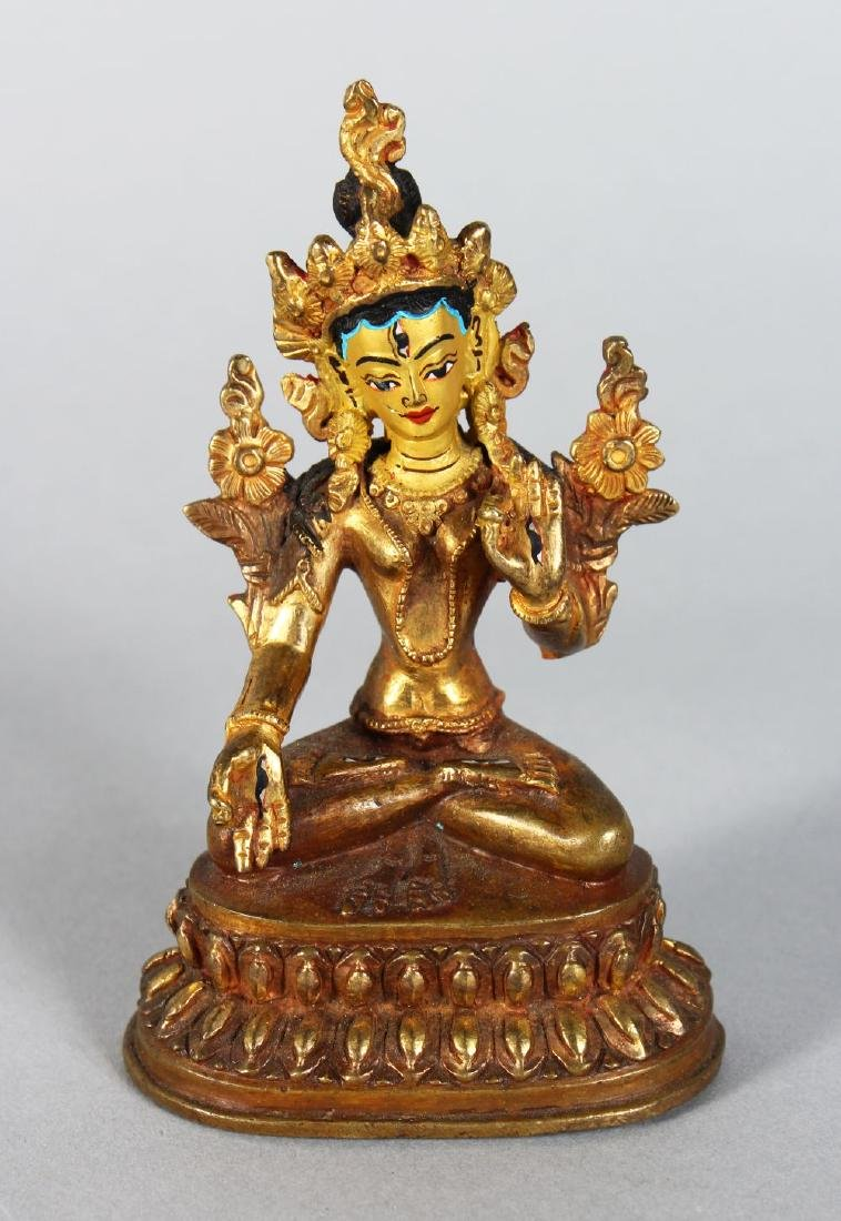 A SMALL CHINESE GILT BRONZE DEITY. 4.5ins high.