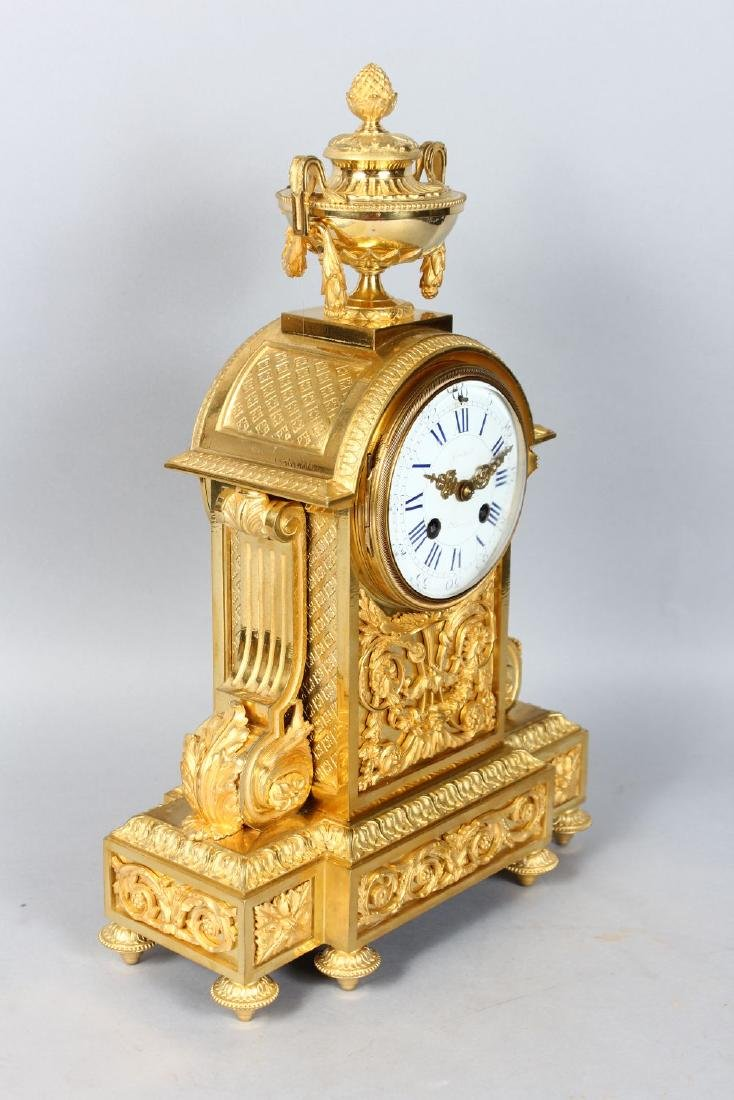A 19TH CENTURY FRENCH ORMOLU MANTLE CLOCK, with - 2