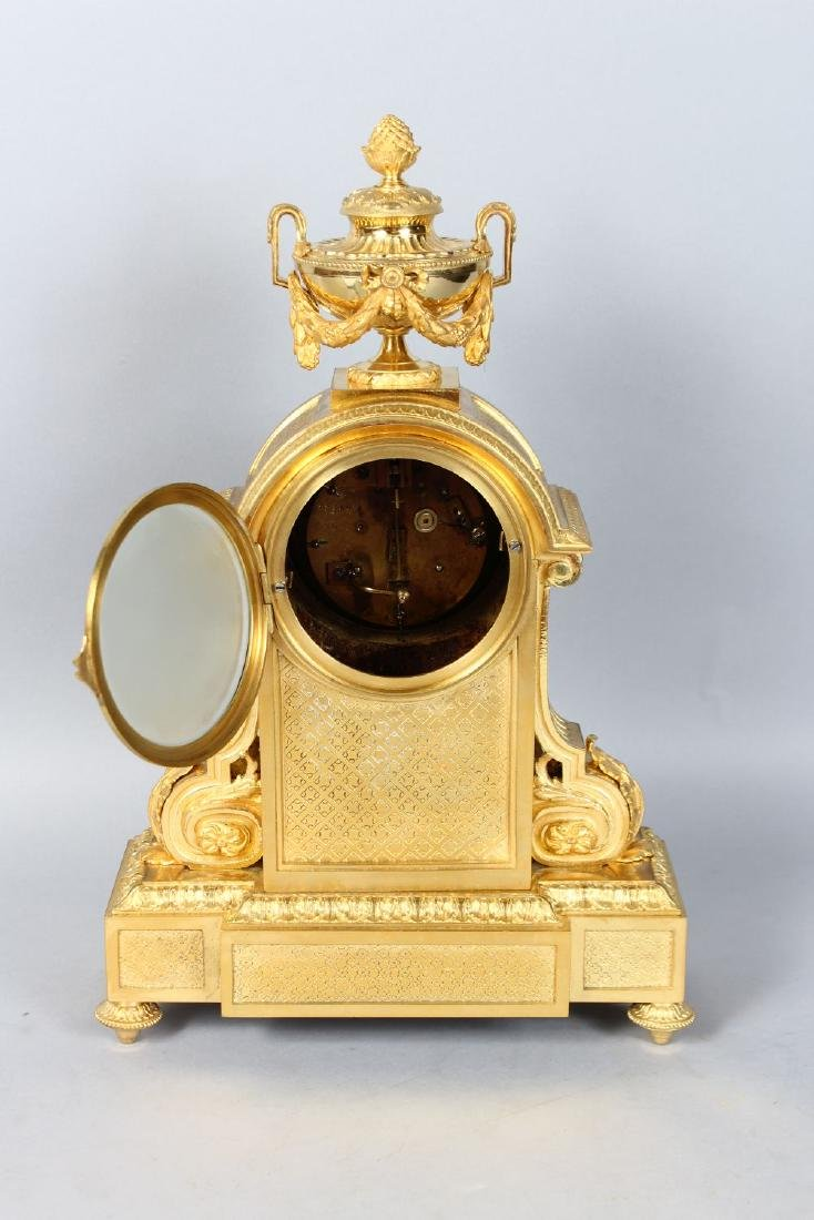 A 19TH CENTURY FRENCH ORMOLU MANTLE CLOCK, with - 3