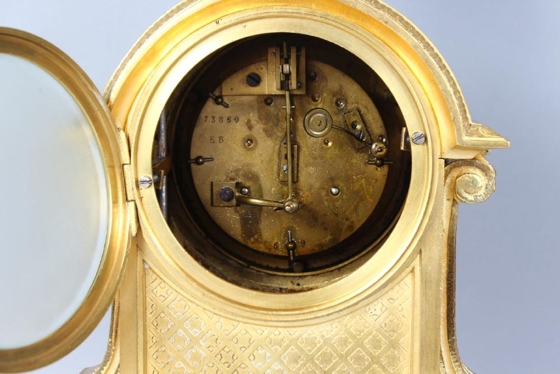 A 19TH CENTURY FRENCH ORMOLU MANTLE CLOCK, with - 4