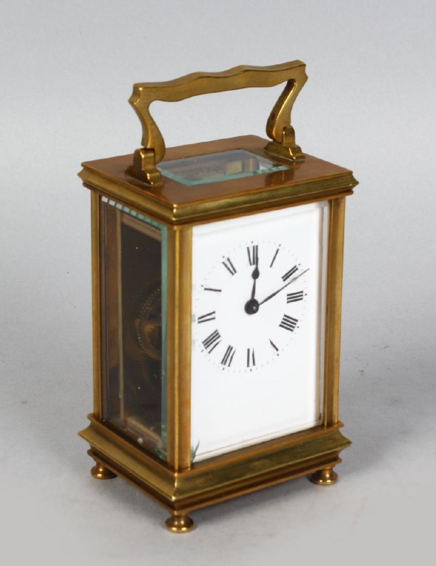 A 19TH CENTURY FRENCH BRASS TIMEPIECE CARRIAGE CLOCK.