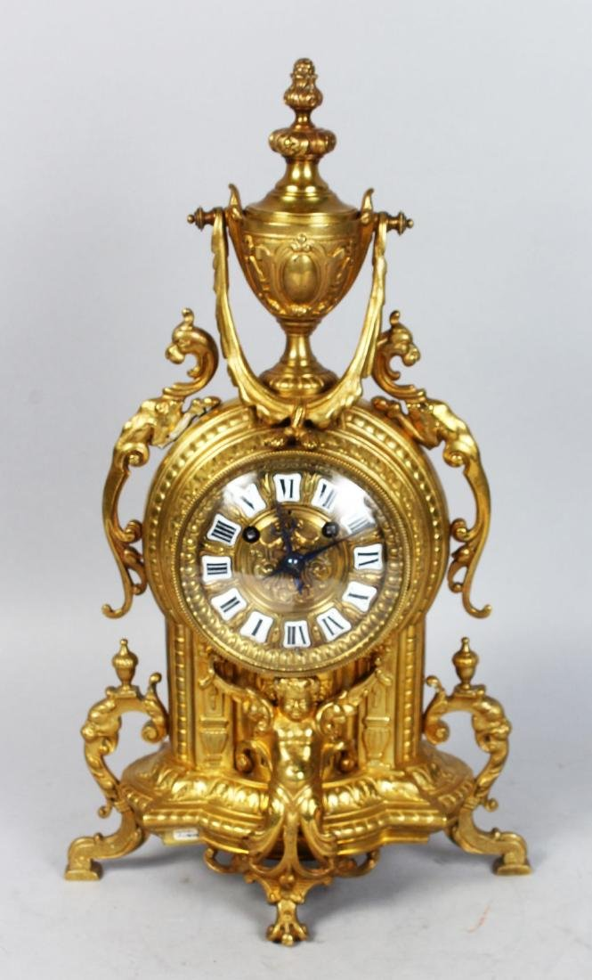 A 19TH CENTURY FRENCH BRASS MANTLE CLOCK, with
