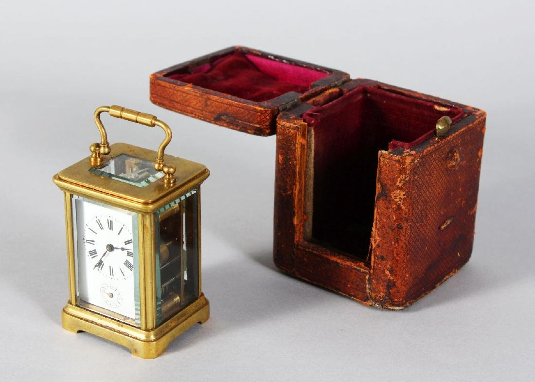 A MINIATURE FRENCH BRASS ALARM CARRIAGE CLOCK.  3.7ins