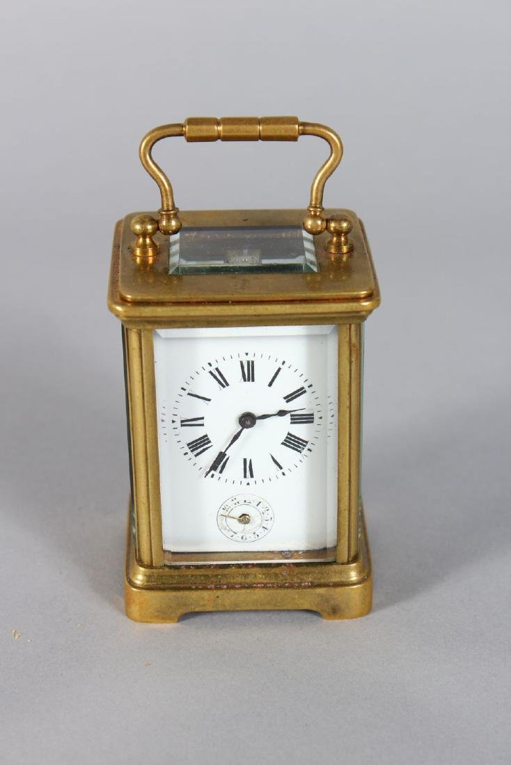 A MINIATURE FRENCH BRASS ALARM CARRIAGE CLOCK.  3.7ins - 2