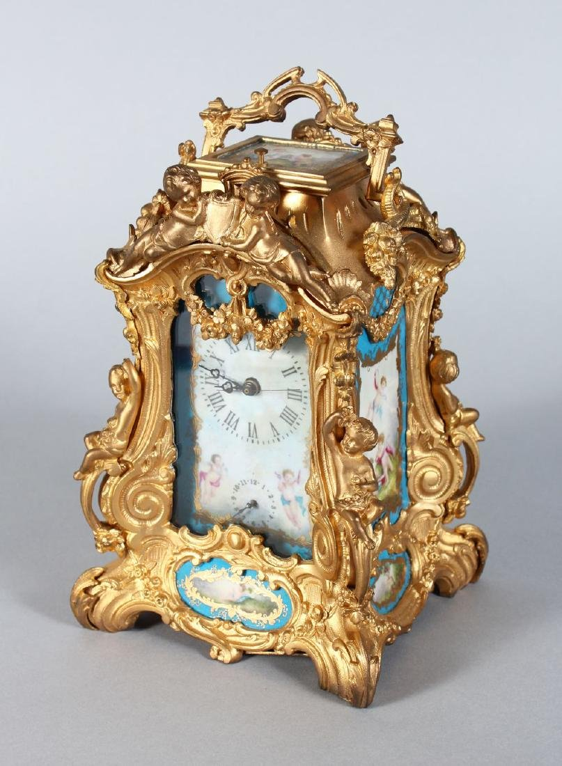 A FRENCH ORMOLU REPEATER CARRIAGE CLOCK with painted