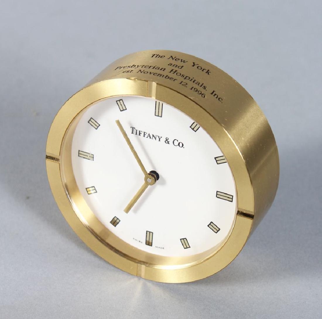 A TIFFANY & CO. CIRCULAR DESK CLOCK. 3ins diameter.