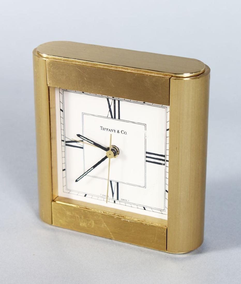 A TIFFANY & CO SQUARE DESK CLOCK. 4ins diameter.