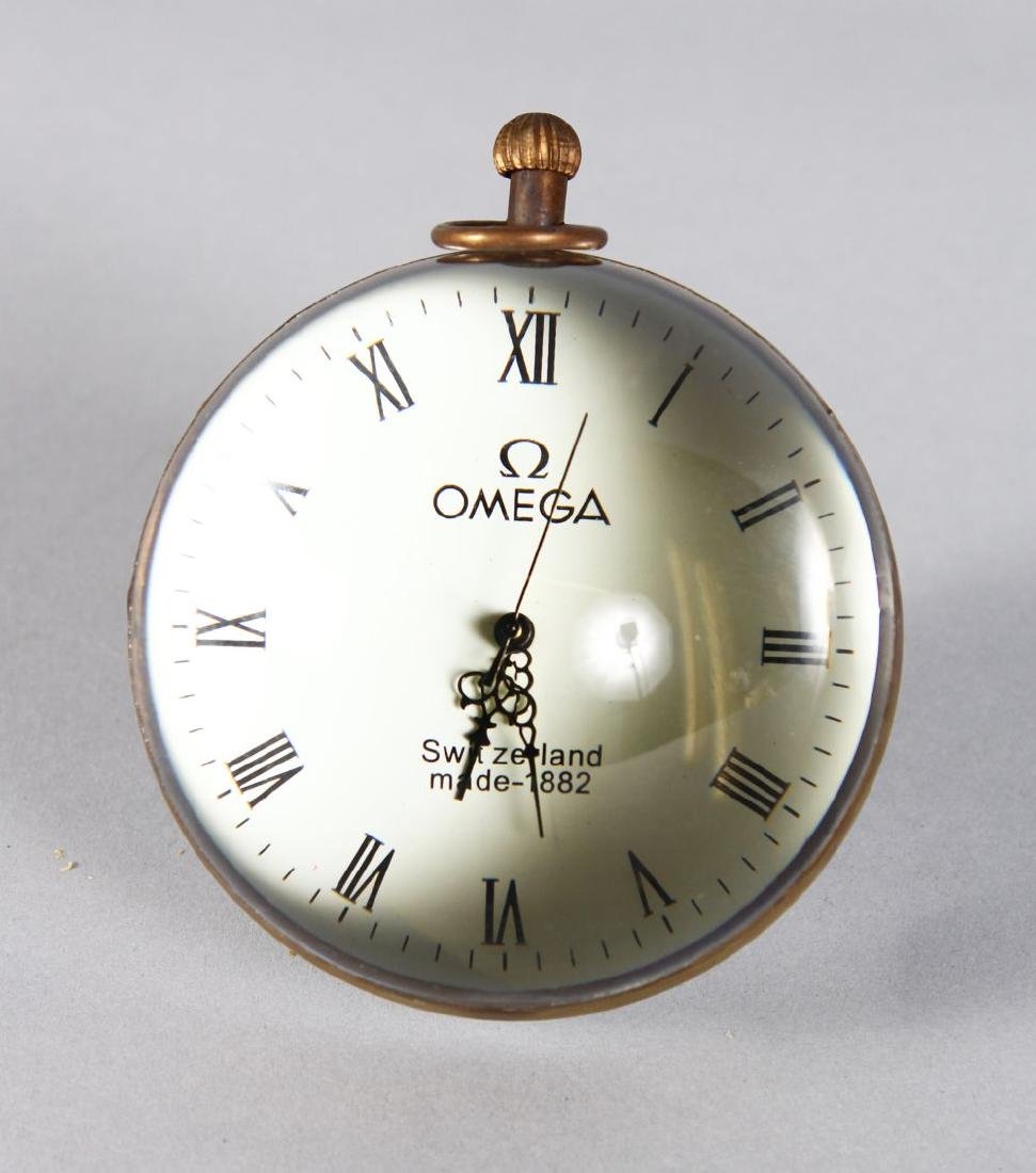 """A LARGE """"OMEGA"""" STYLE BALL CLOCK. 3ins diameter."""