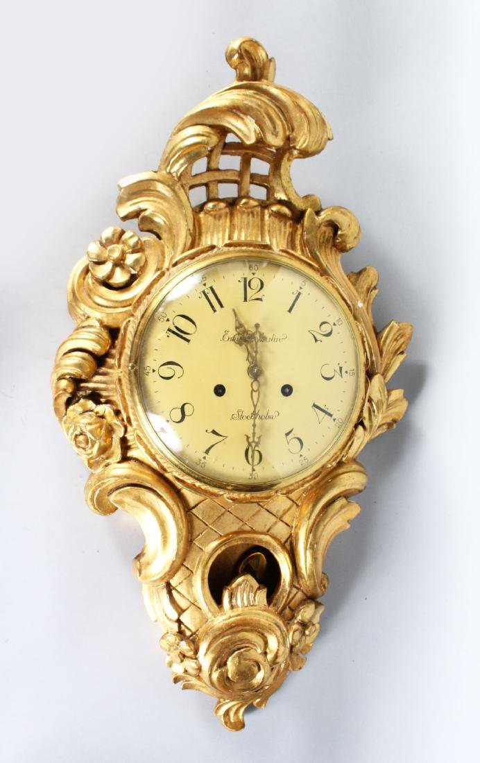 A CARVED AND GILDED CARTEL CLOCK, 20th Century. 26ins