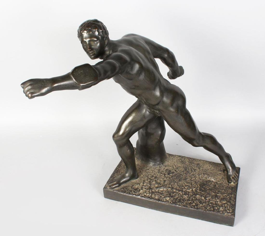 AFTER THE ANTIQUE  A BRONZE RESIN FIGURE OF A MALE