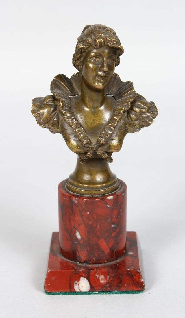 A GOOD SMALL BRONZE BUST OF A LADY on a marble column.