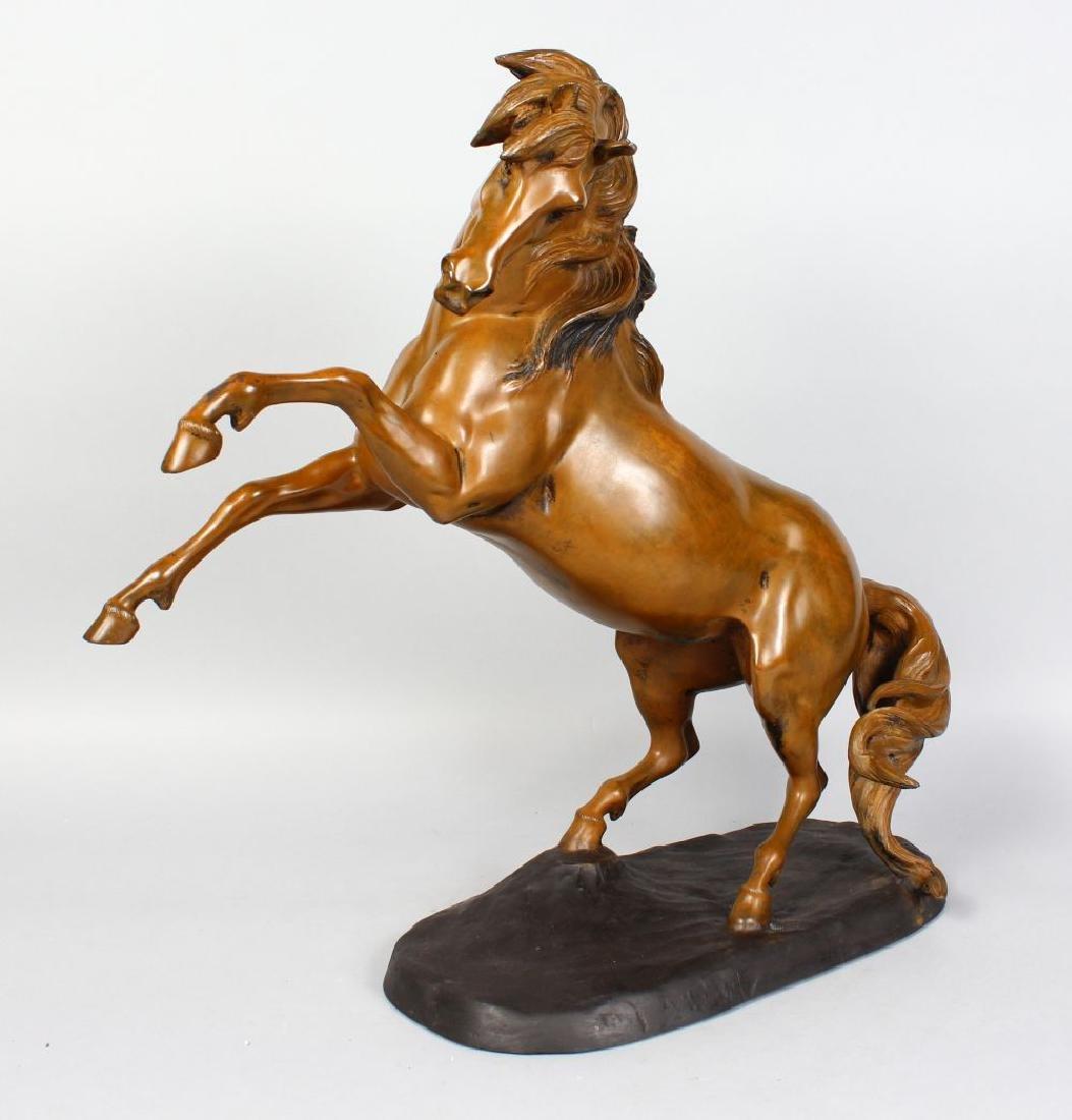 HUNT (20TH CENTURY) BRITISH  REARING HORSE, patinated