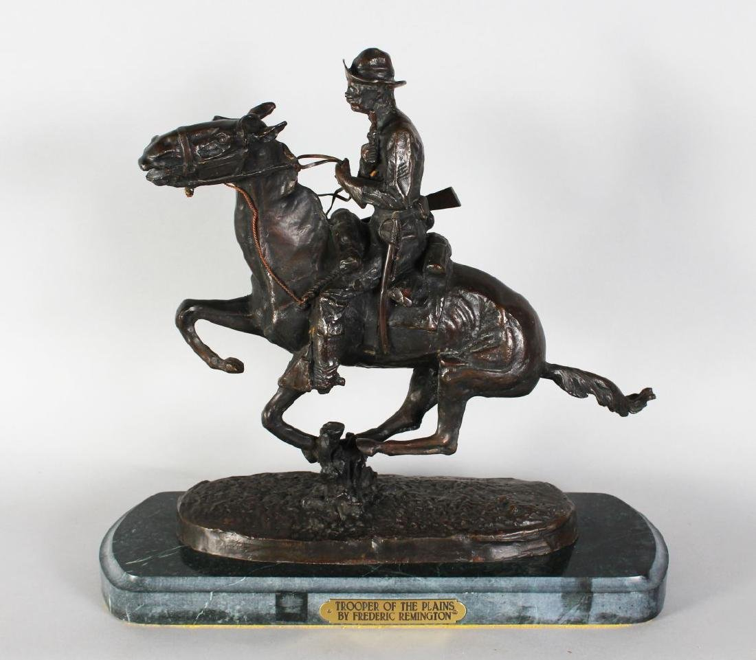 AFTER FREDERIC REMINGTON  A BRONZE OF A CAVALIER ON