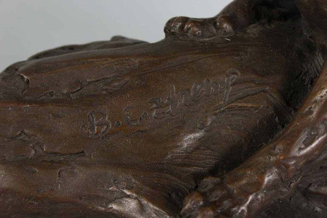A BRONZE OF TWO TIGERS on a rock.  Signed, on an oval - 3