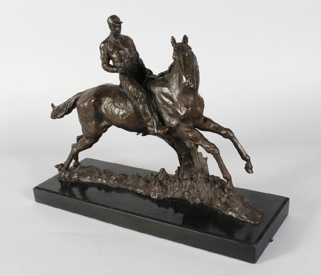 A BRONZE HORSE AND JOCKEY.  Signed, on a rectangular