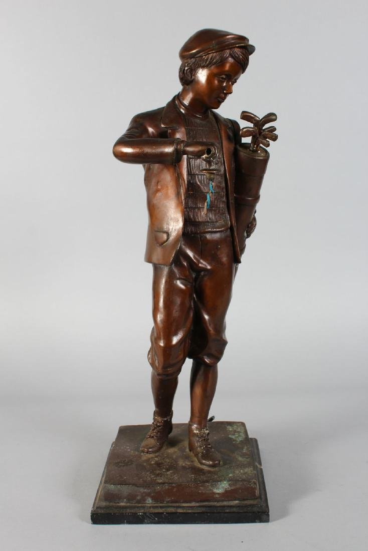 A  BRONZE OF A YOUNG GOLFER carrying a bag of golf - 2