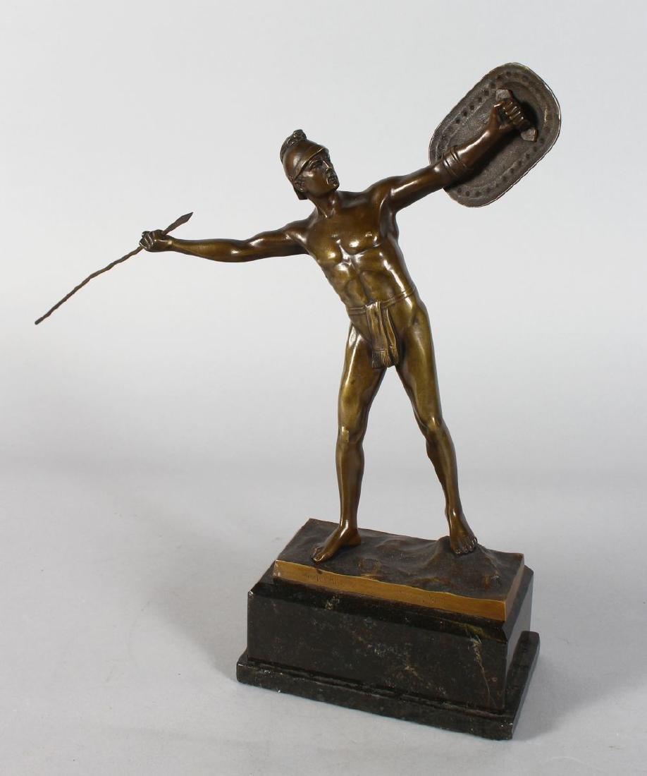 A BRONZE OF A ROMAN FIGURE throwing a javelin  stnding