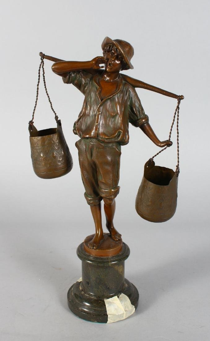"A BRONZE OF A YOUNG BOY ""THE WATER CARRIER""  on a"