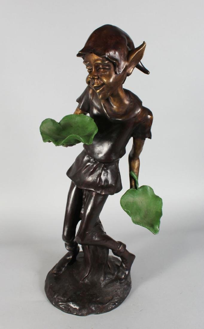 A TWO COLOUR BRONZE PIXIE holding two leaves.  31ins