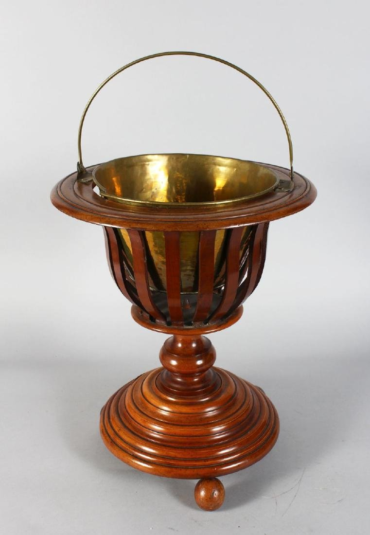 A DUTCH WOODEN BUCKET with brass liner and handle.