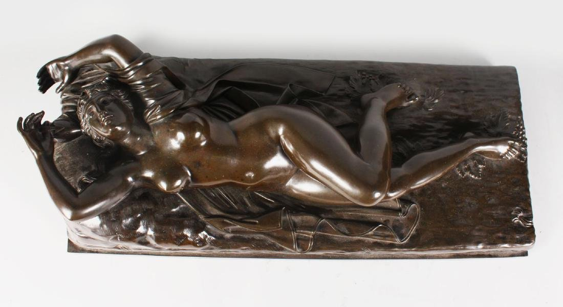 A LARGE BRONZE OF A RECLINING NUDE.  32ins long.