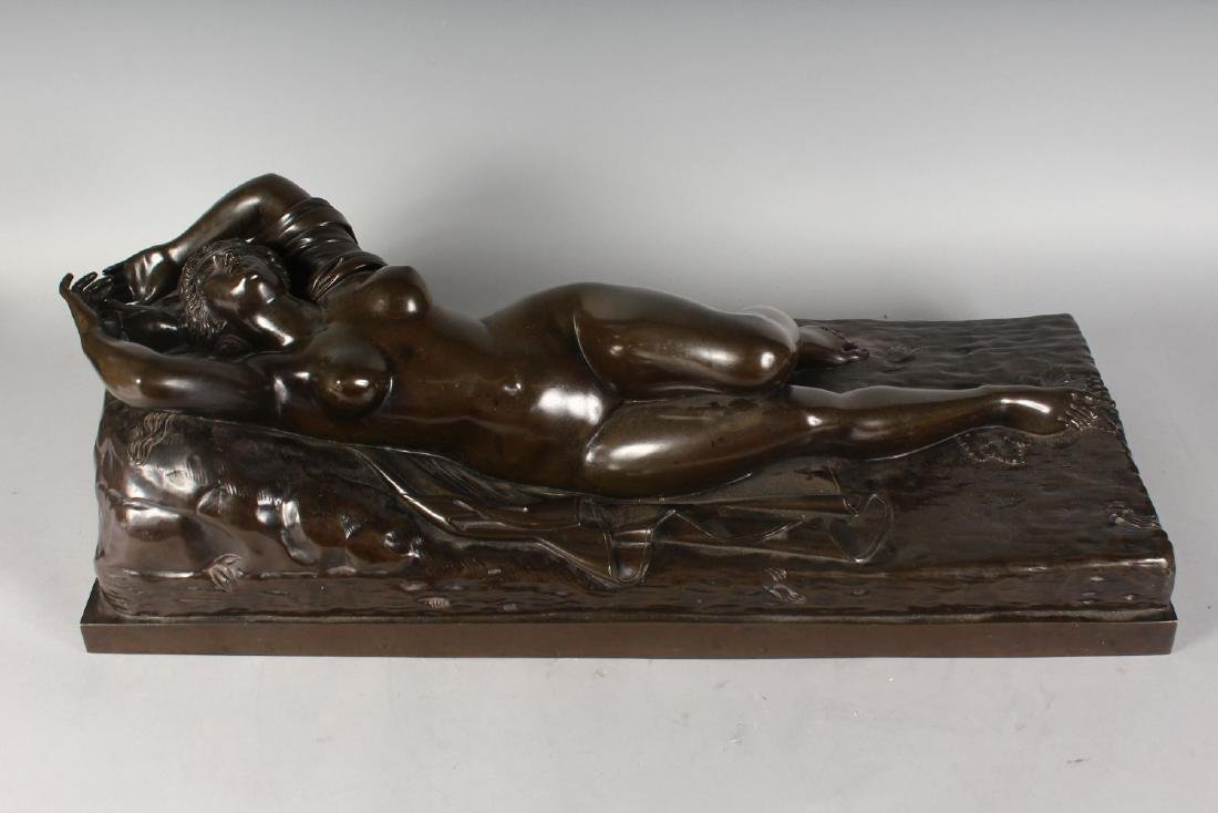 A LARGE BRONZE OF A RECLINING NUDE.  32ins long. - 2